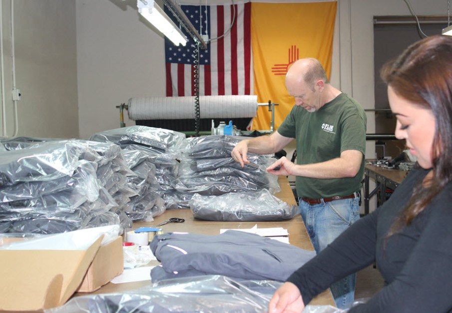 Eric and Violet Ahmie packaging coats from Apparel Manufacturing Boot Camp
