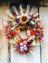 Wreath with many of the popular food crops of New Mexico in celebration of the bounty of the Fall harvest and inspired by the revered and radiating beauty of the Virgen de Guadalupe effigy.