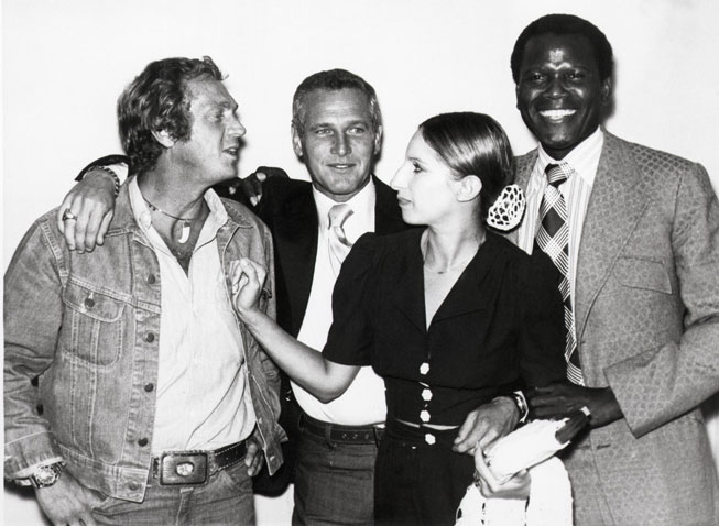 Steve McQueen, Newman, Barbra Streisand, and Sidney Poitier at a meeting for their own film-production company, First Artists, in 1972. © Bettmann/Corbis.