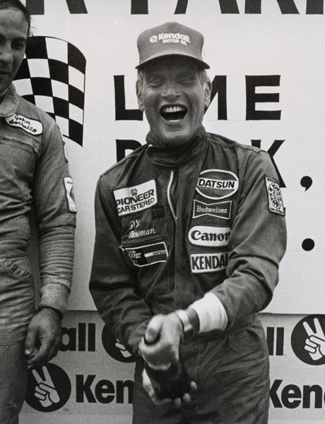 Enjoying another of his passions, auto racing, Newman celebrates at Lime Rock Park racetrack, in Connecticut, July 1980. By Ron Galella/WireImage