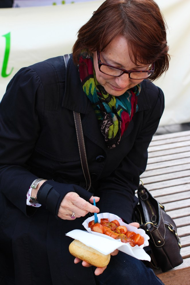 Mom digging into her first currywurst. Needless to say, she approved.