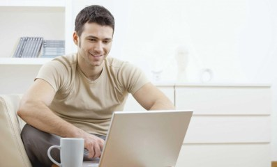 smiling man at laptop