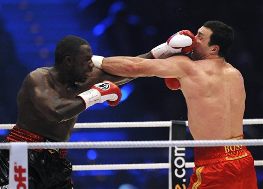 Both Klitschko  and Rahman  land punches during the third round
