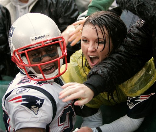 Ellis Hobbs of the Patriots is congratulated by a fan after the  player's TD in Oakland against the Raiders ...........