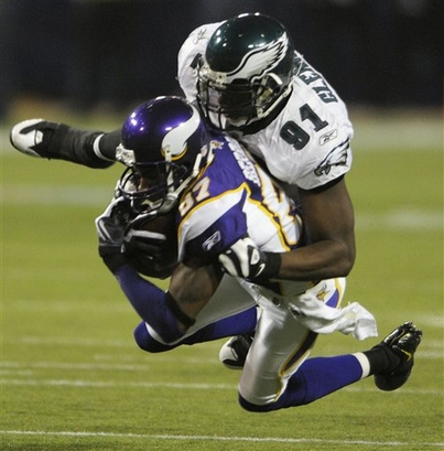 Eagles' defensive end  tackles the Vikings' wide receiver Bernard Berrian ...........