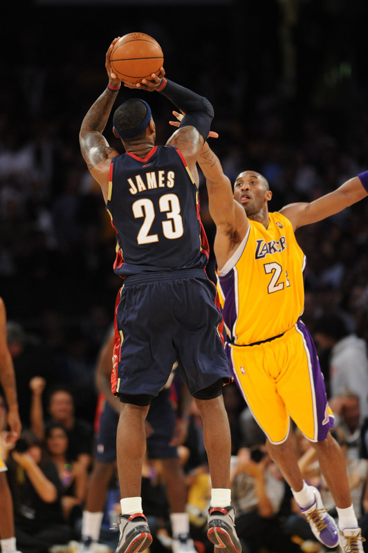 James' jump shot over  the  outstretched  arms  of  the Lakers' Kobe  Bryant  ..............