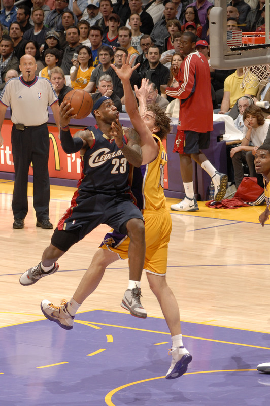 LeBron James drives  for the basket  under the  defensive presence  of  Pau  Gasol of  the  Los Angeles  Lakers ............