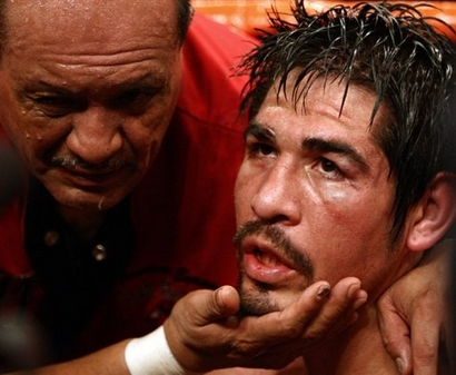Margarito  sits  in  his  corner  dazed  and  confused  having  lost  his  WBA welterweight title  to  Shane Mosley  in  ninth round by  a TKO ..................