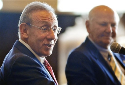 Billionaire  real estate  developer  and  now  principal  owner  of the  Miami  Dolphins  Stephen Ross (left)  seated  alongside  H D Wayne  Huizenga   who sold  a  majority  stake in the franchise  to  the  developer........