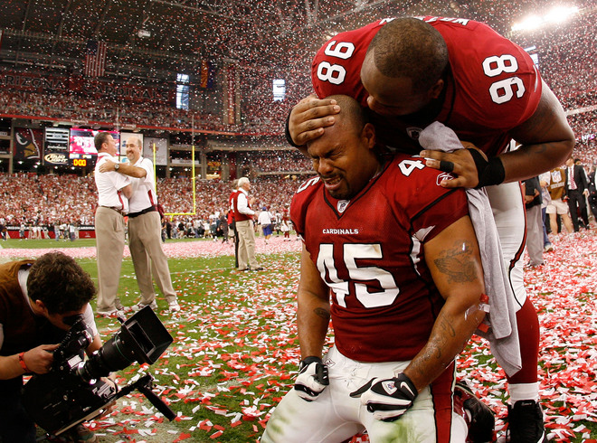 Terrelle  Smith and  Gabe Watson  of the  Arizona  Cardinals are  overwhelmed  with  emotion after  the  team's victory  over  the  Philadelphia  Eagles  in the  NFC  championship  game ....................