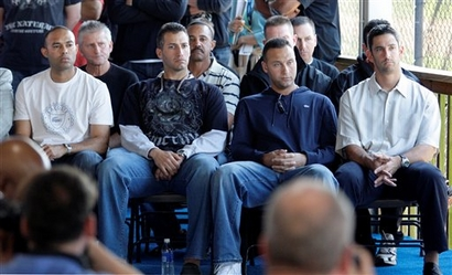 Mariano Rivera , Andy Pettite  , team captain  Derek Jeter and  Jorge  Posada  all  seated listen  Rodriguez's  statement  to the  press.