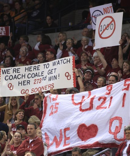 Sooners' fans acknowledge  Summitts  attempt at making  history but  they  also  acknowldge Soonners'  coach  Sherri Coales' attempt  at winning  her  273rd game  .  picture appears courtesy of ap/photo/ Sue  Ogrocki  ..........