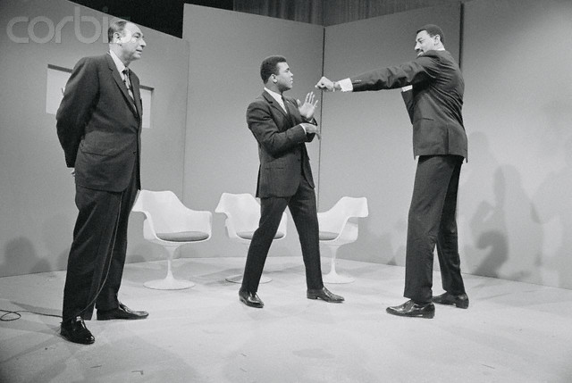 Ali  playfully  avoids  a jab  from  Wilt  Chamberlain  during  the  taping  of  a  television  show.  Chamberlain  at  the  time  wanted to  meet  Ali in an  exhibition  bout.