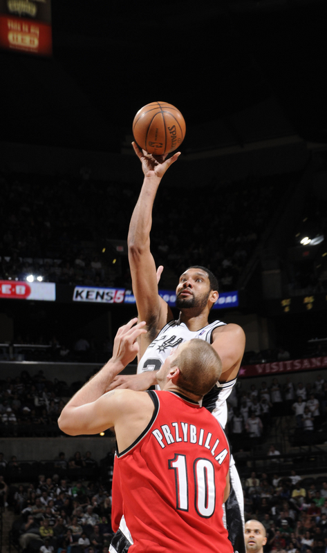 Joel Pryzbilla of the Portland  Trailblazers  tries  to  negate the  offensive  play of the Spurs' Tim  Duncan.