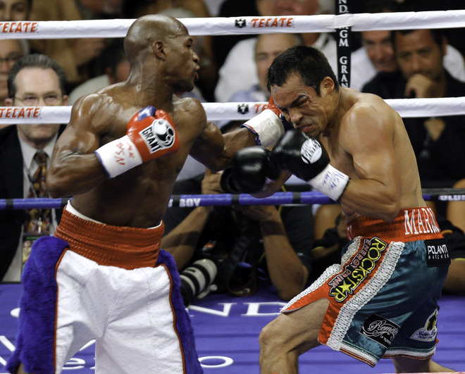 Mayweather  on  the  attack  as  he   takes  the  fight  to  Marquez.   Mayweather   would   end  up winning  the  fight  decisively  with a  unanimous   verdict  over  his  Mexican   opponent  ,  Juan  Manuel  Marquez.      picture appears  courtesy  of   getty  images/  Eric  Jamison  .............