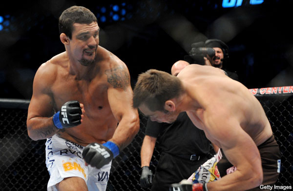 Vitor Belfort (left)  on  his  way  to  victory by  knocking  out  Rich  Franklin (right) in their  light  heavyweight   bout  at   UFC 103   held at  the  American  Airlines  Arena  ,  Dallas  ,  Texas .   picture  appears  courtesy of  getty images  @   copyrighted material  ......All  rights reserved