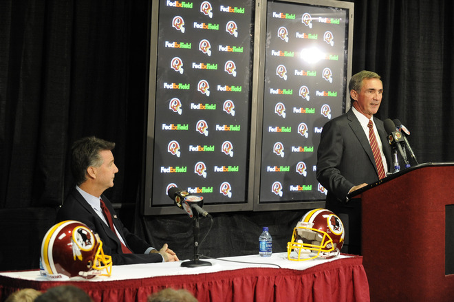 Ashburn , Va,. Mike Shanahan speaks at a press conference introducing him as the new Executive Vice President and Head Coach of the Washington Redskins as  Bruce Allen, Executive Vice President and general manager watches on January 6, 2010 at Redskins Park in Ashburn, Virginia.  picture appears courtesy of  Getty Images / Mitchell  Layton ........