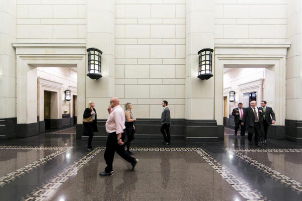 Office workers walk out of the lifts into the hallway at 333 Collins Street also known as Melbourne's most exclusive address housing, once The former Banking Chamber & Vestibule of the Commercial Bank of Australia Ltd it is now as exclusive office building.