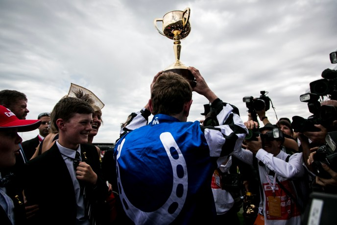 Winning Jockey Ryan Moore who rode Protectionist to win the Emirates Melbourne Cup raises the trophy during the Emirates Melbourne Cup Day held at Flemington Racecourse in Melbourne Australia.