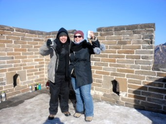 My brother and I drinking a beer on the Great Wall of China.