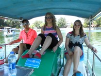 Pedal boats are fun, but Tom had trouble steering. So Sara operated the rudder while Kerri and Tom pedaled.