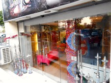 A colorful storefront selling hookahs.