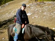 I got Mom on a horse!