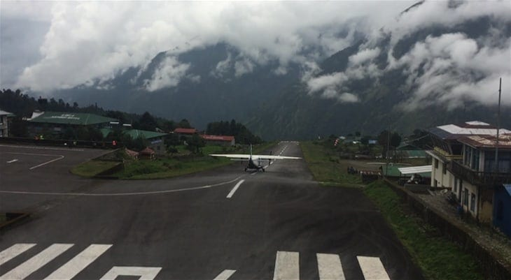 "A plane taking off from Lukla Airport, ""the most dangerous airport in the world"".  Landing in Lukla marks the start of adventure for most hikers on the Everest Base Camp Trek"