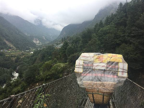 All along the Everest Base Camp Trek, porters carry 60-100lb loads