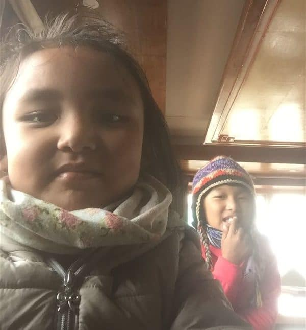 Pheriches Edelweiss welcome staff teaching me how to properly take a selfie - they demanded help with their English homework as payment. On the Everest Base Camp Hike between Tengboche and Gorak Shep