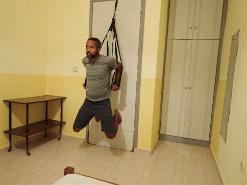 The suspension trainer also allows me to do dips, another essential upper body movement, as part of my hotel room workout
