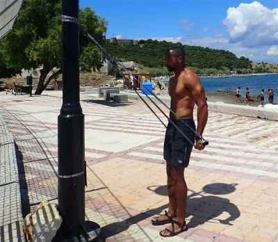 A great, muscle building triceps workout is easy on the road as long as you have a suspension trainer and know how to use it