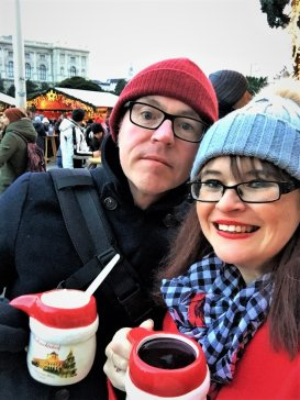 Enjoying a hot punsch at Vienna's Marie-Theresien-Platz Christmas Market