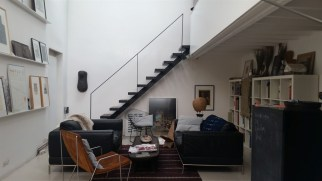 The living room where we read Le Monde in an attempt to become more French. Those stairs go to our bedroom.