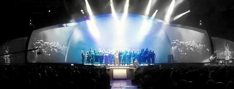 Performers singing on stage