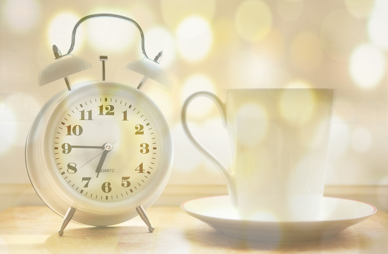 alarm clock, coffee cup, time of