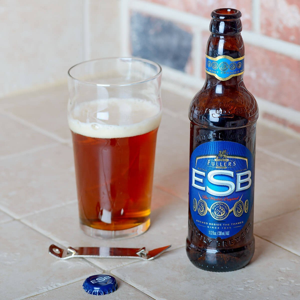 Fuller's ESB is a Strong Bitter brewed by Fuller Smith & Turner PLC that has a bite of floral and earthy hops, fruit, booze, toast, and chocolate.