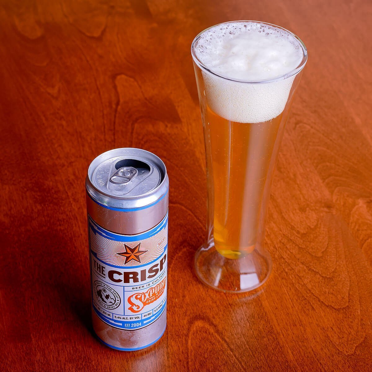 The Crisp is a German-style Pilsner by Sixpoint Brewery that's light and refreshing with peppery hops, lemon citrus, cracker, and honey.