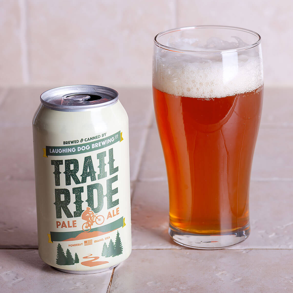 Trail Ride is an American Pale Ale by Laughing Dog Brewing that's dominated by floral, herbal, and citrus hops and balanced by toast and caramel.