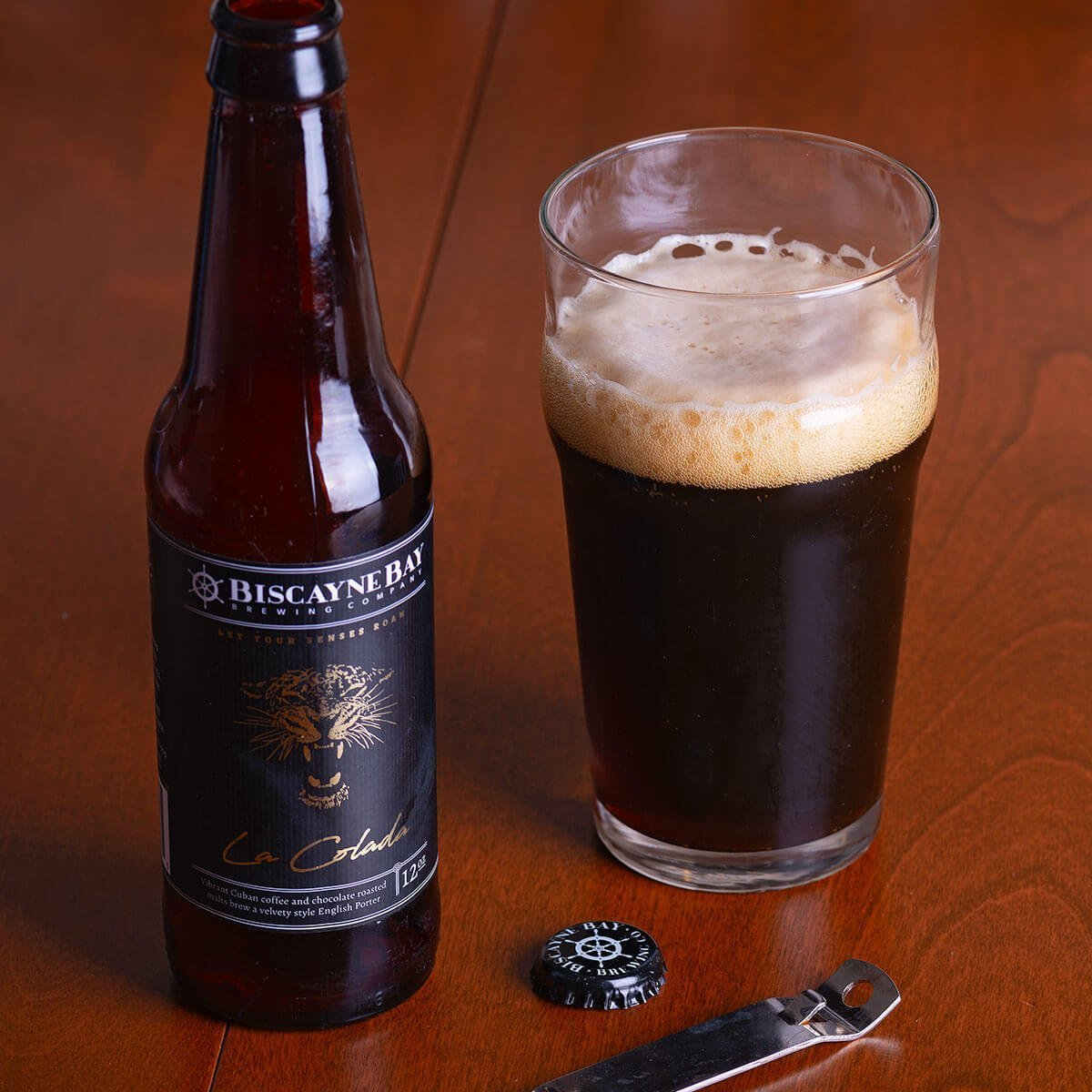La Colada is an English-style Porter brewed by Biscayne Bay Brewing Company that blends Cuban coffee, lactose, chocolate and toasted malts.
