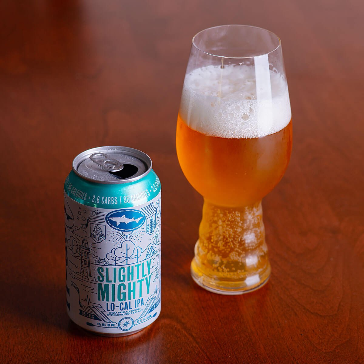 Slightly Mighty is a low-calorie American IPA by Dogfish Head Craft Brewery that features hoppy citrus, tropical fruit, and coconut.