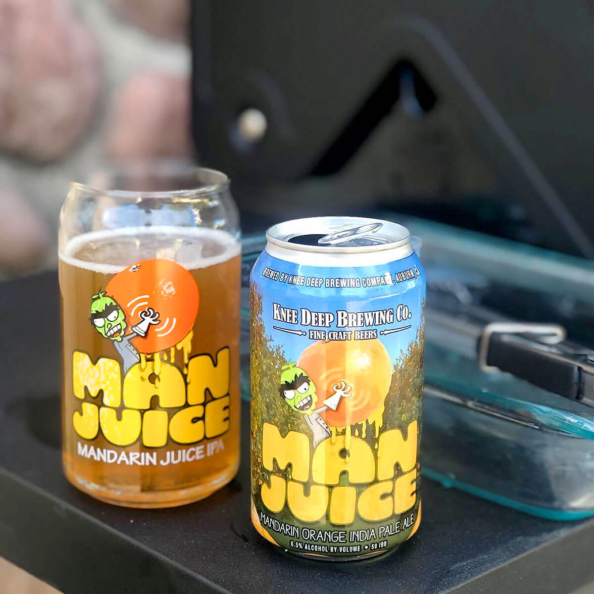 Man Juice is an American IPA that's brewed by Knee Deep Brewing Co. that pairs hoppy citrus with mandarin orange juice.