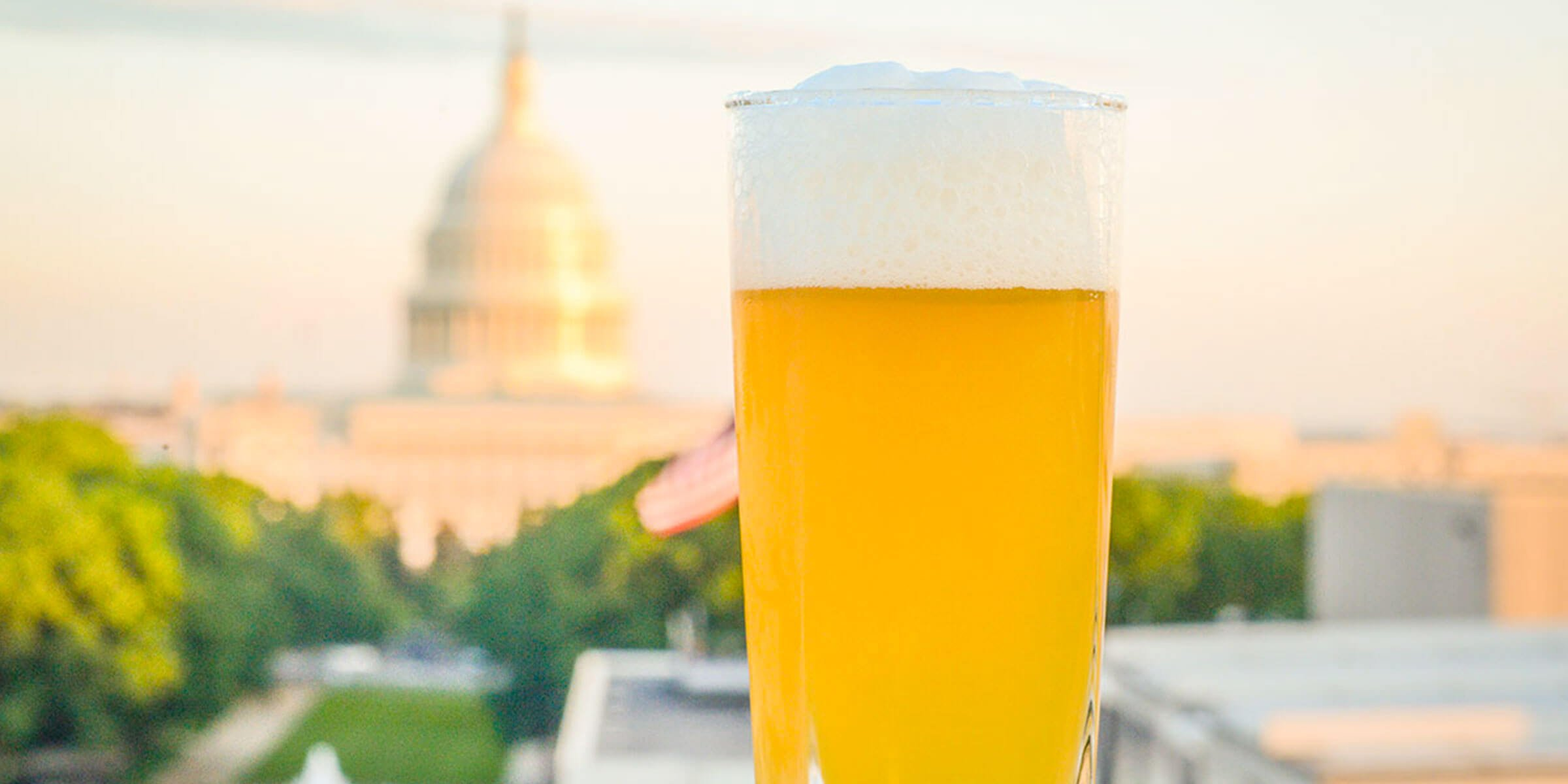 Beer in a glass in front of the U.S. Capitol Building in Washington, DC