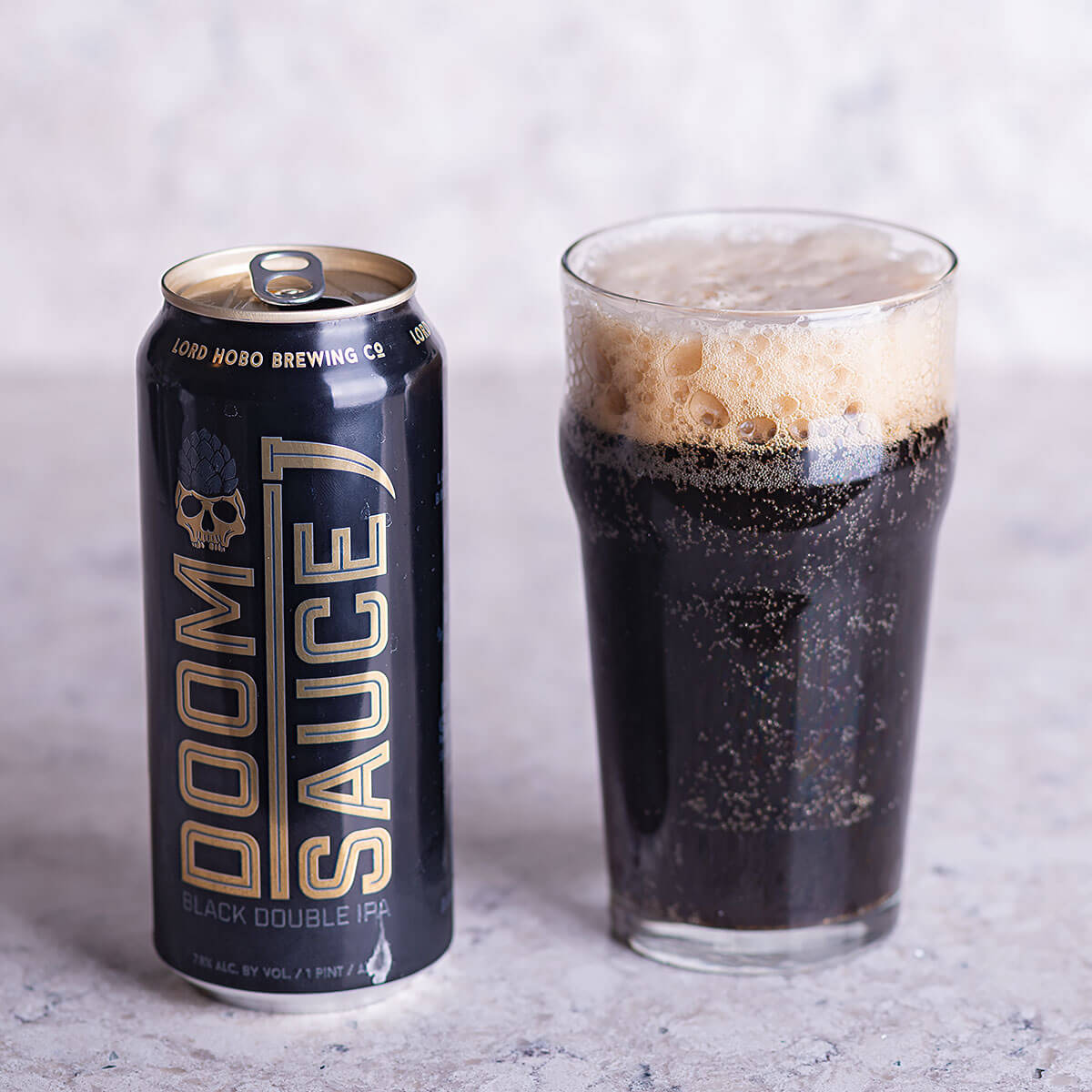 Doomsauce is an American Black Ale by Lord Hobo Brewing Co. that balances floral, pine, and resin hops with brown bread, roast, and dark chocolate.