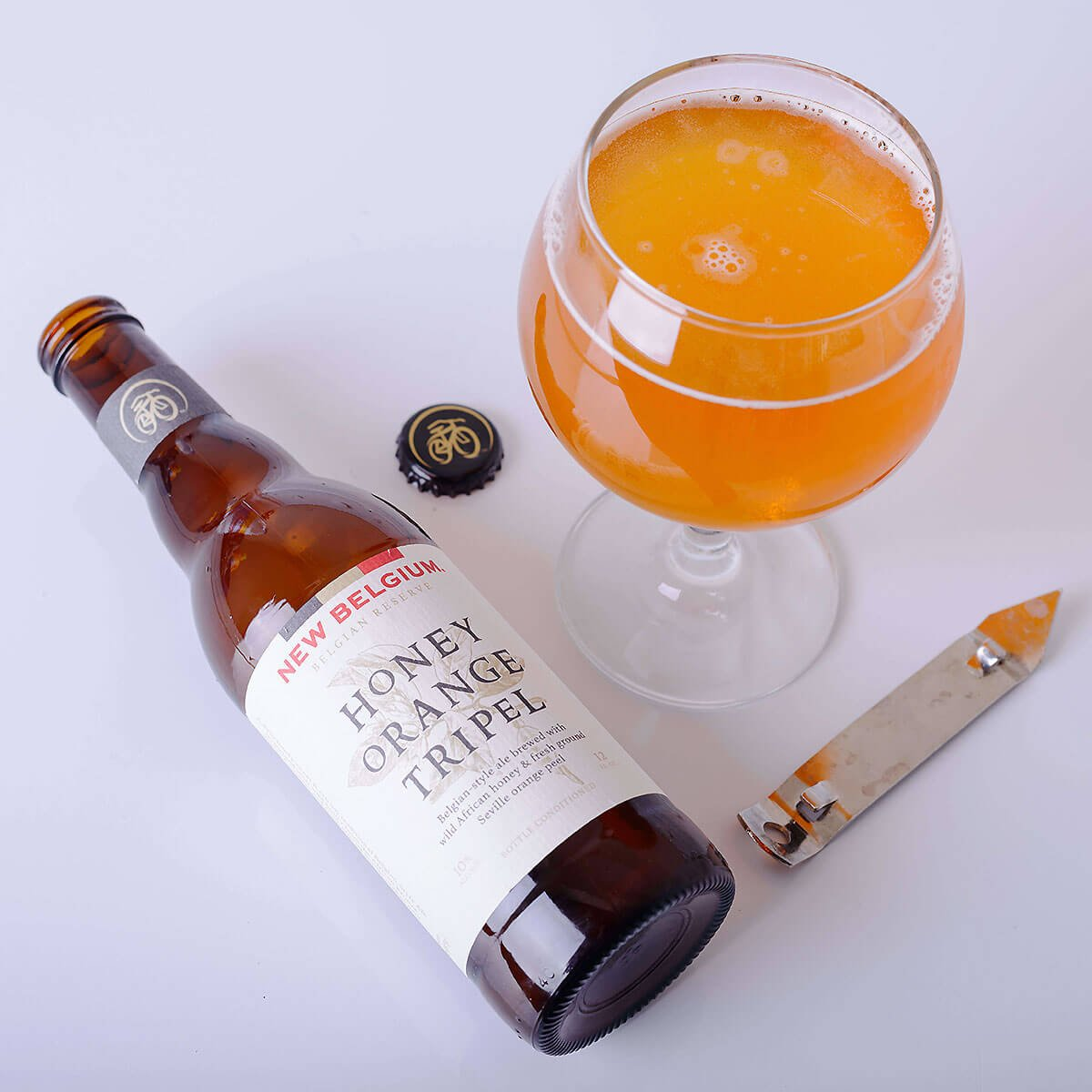 Honey Orange Tripel is a Belgian-style Tripel by New Belgium Brewing Company that blends sweet candied orange and honey with a light citrus and spices.