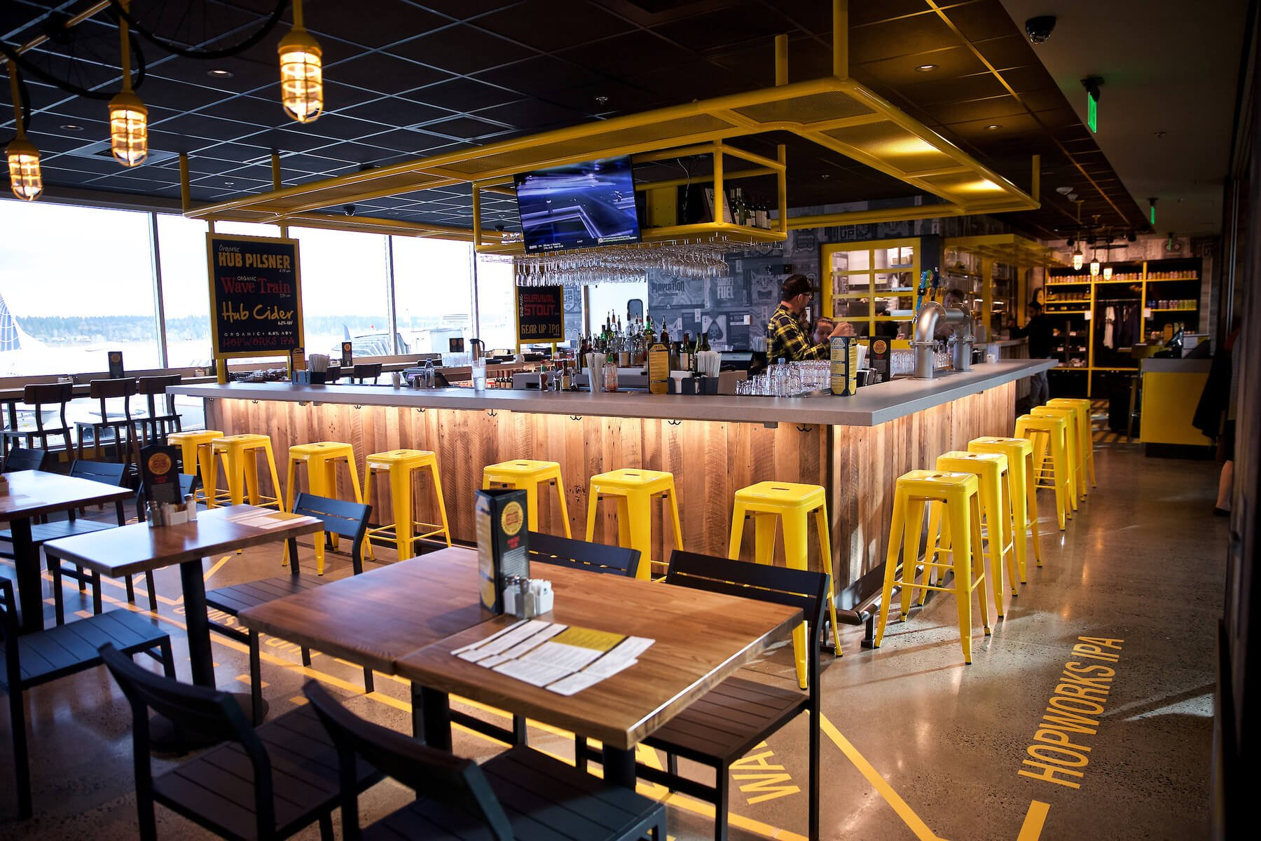 Inside the taproom at the Hopworks Urban Brewery PDX Airport location in Portland, Oregon