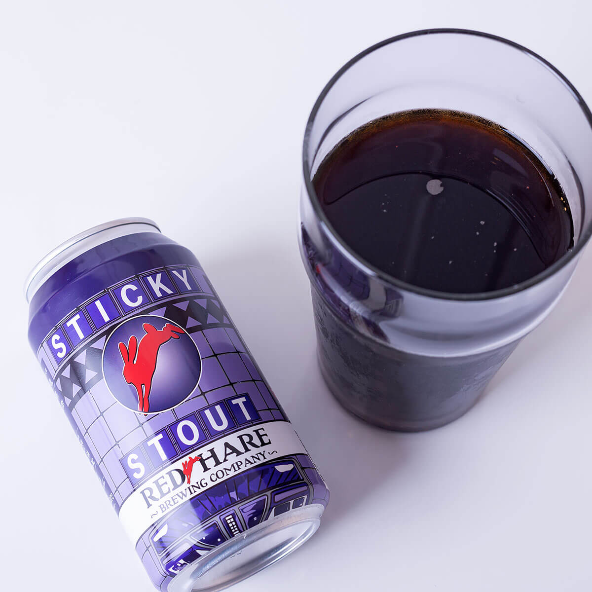Sticky Stout is an English-style Oatmeal Stout by Red Hare Brewing Company that blends roast malt, floral hops, and sweet dark fruit.