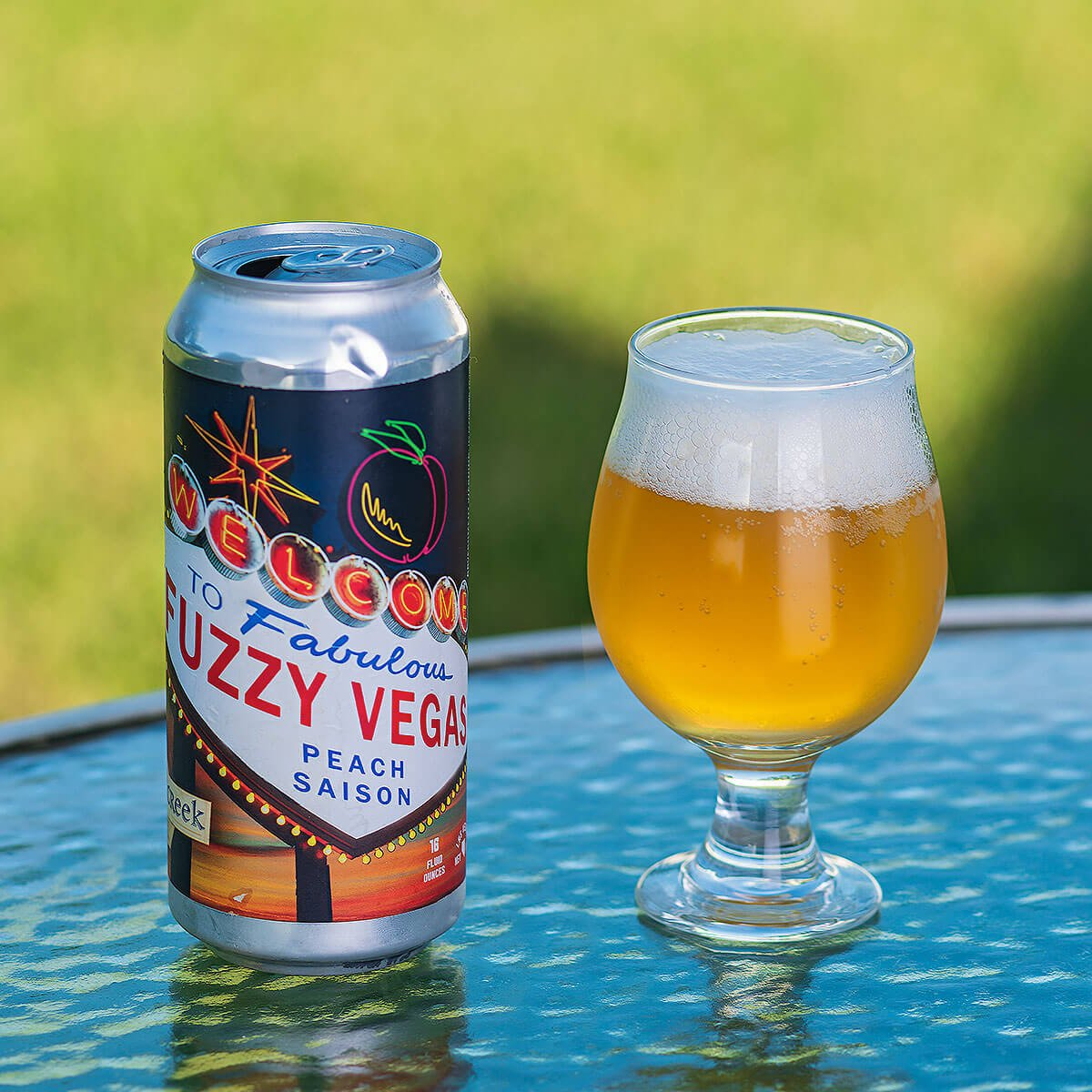 Fuzzy Vegas is a Belgian-style Saison by Tenaya Creek Brewery that blends a traditional Farmhouse Ale with sweet peaches.
