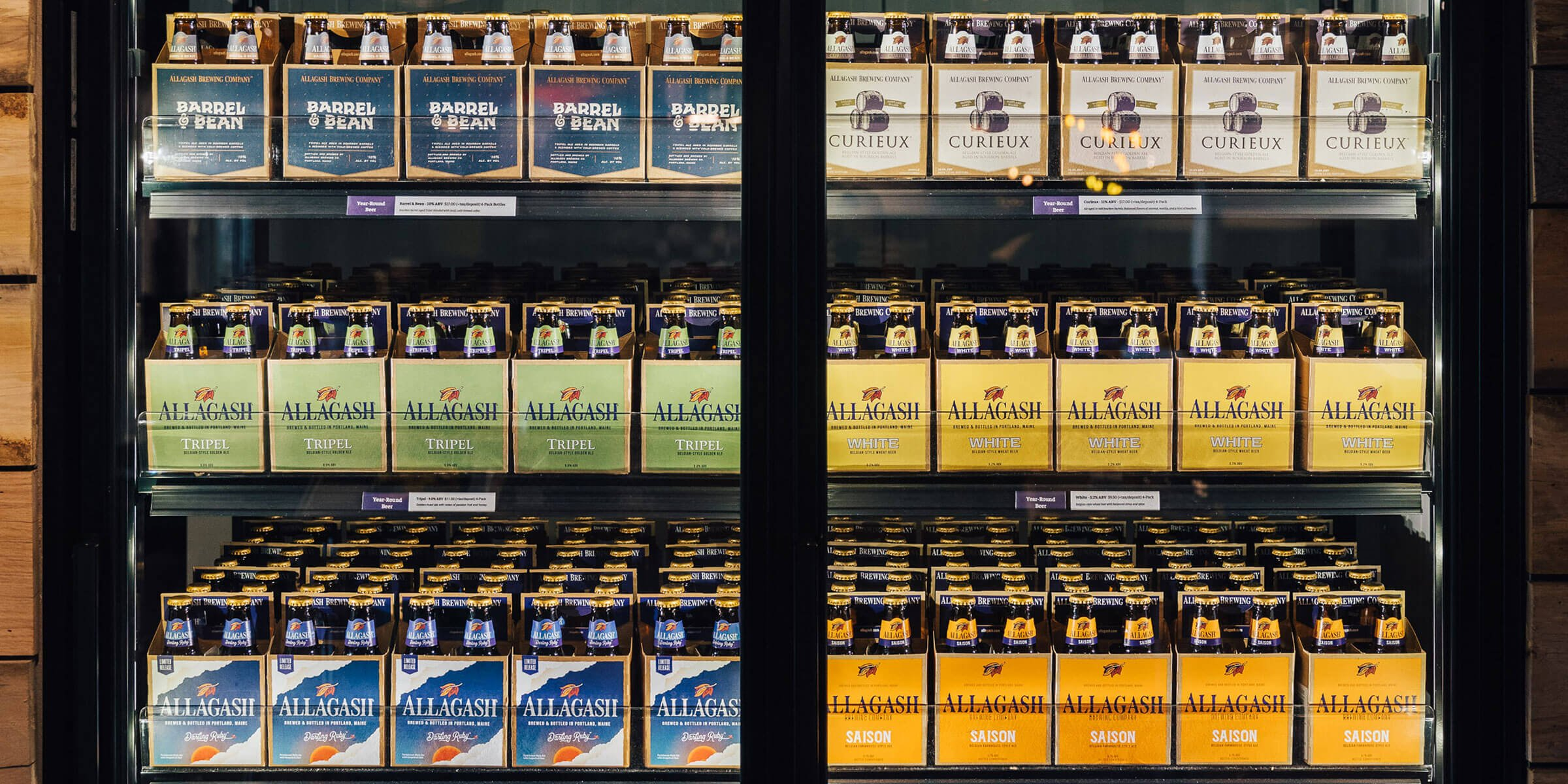 Cooler of four packs of various bottled beers offered by Allagash Brewing Company