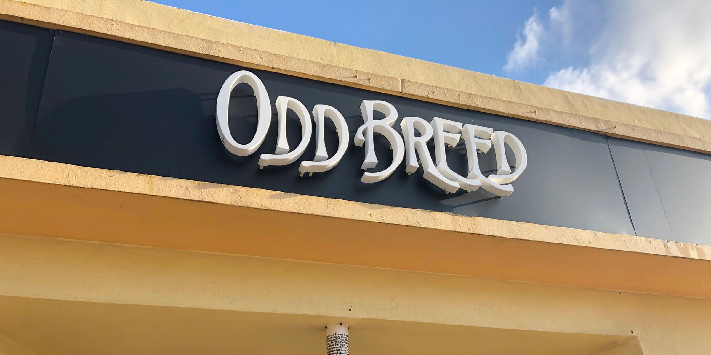 Signage above the entrance to Odd Breed Wild Ales in Pompano Beach, Florida
